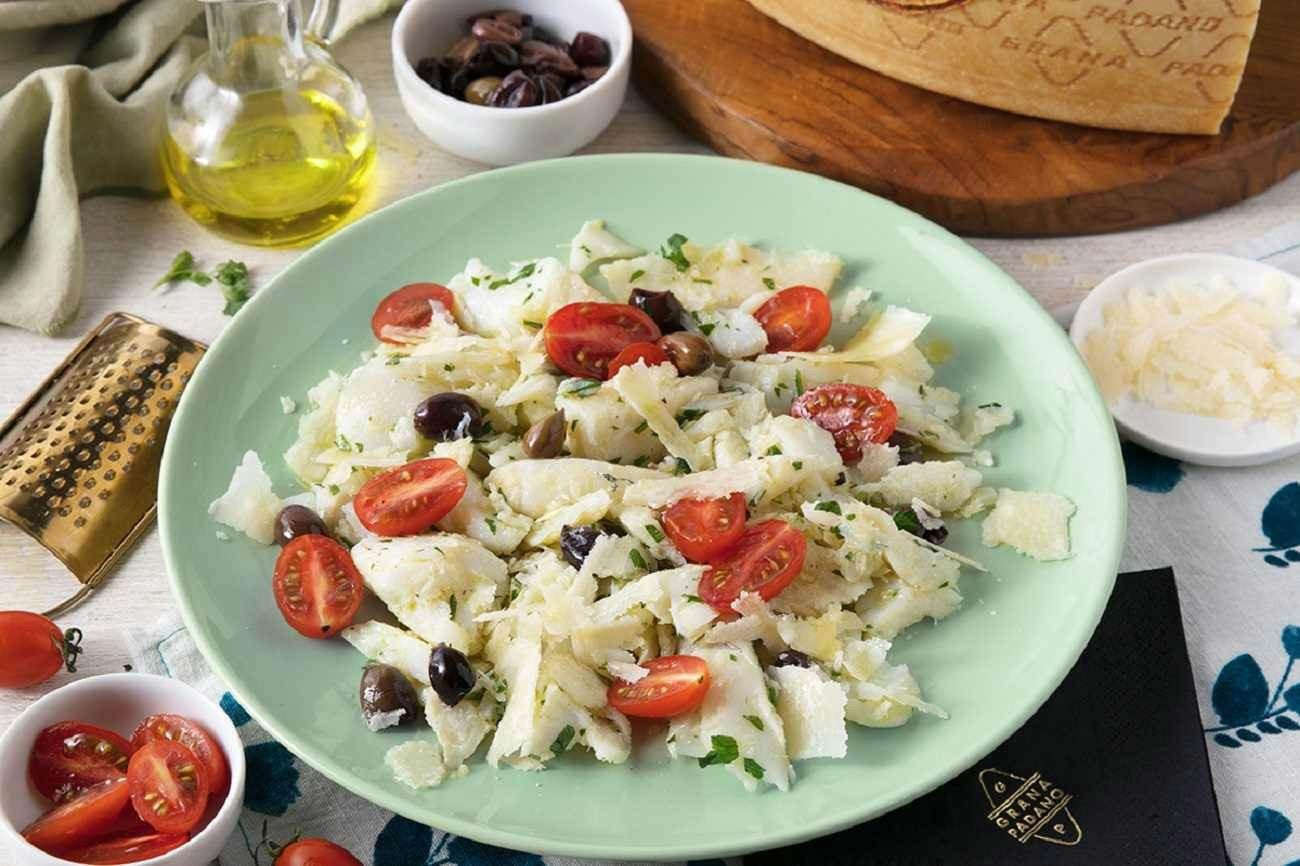 Insalata di baccalà con pomodorini, olive taggiasche, prezzemolo e grana padano Fattorie Cremona